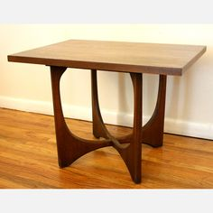 mid-century modern side end table by J.B. Van Sciver is constructed of solid wood with a gorgeous sculptural base and glass top for optional use. Its clean, organic form adds functional beauty to any room. $395