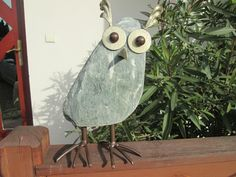 owl made of stone (green serpentinite) and steel