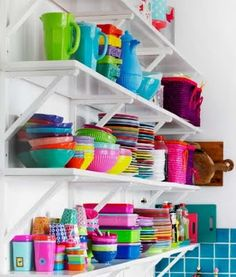 More colour.  Looks like melamine which reminds me how much I like Meleware.  This is here to remind me that open shelves as opposed to just a wall full of cabinets can help make spaces look a bit eclectic.