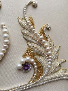 Detail of Ornate letter. Pearl embroidery done by Larissa Borodich: