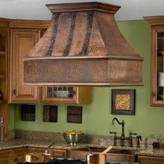 """Add the stunning 36"""" Tuscany Solid Copper Island Range Hood as the focal point to your gourmet kitchen."""