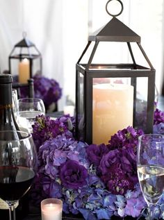 Purple hydrangea candle lit lantern wedding centerpiece