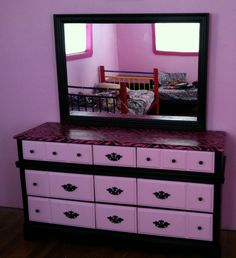 And the dresser after with black paint and zebra fabric and mod podge man I loved doing this my daughters love it just as well!!! So see you dont have to go and buy fancy stuff just use what you have around your house and shop and you be surprised!!
