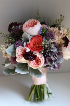 Great colors: poppies,garden roses, scabiosa, hydrangea and dusty miller.