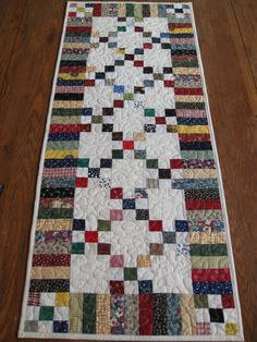Scrappy nine patch.  This would make a beautiful bed runner done in  the right colors for the room.