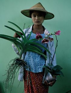 Woman with Orchids in 'Gilt Trip' by Tim Walker for W Magazine, May 2014.
