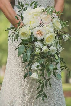Cascading Blush Bouquet of Garden Roses, Peonies, and Greenery. Jessica and Michael's charming wedding in Bluffton, South Carolina was practically brimming with gorgeous blooms. The bride's bouquet was no exception. She chose a cascading arrangement (a re
