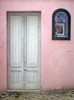 Grey doors on pink walls.