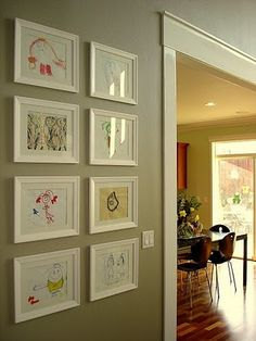 framed children's art, this is so chic and sophisticated.  Instead of hanging them all on the fridge and running out of room and/or stuffing them in the baby book, never to be seen. { I will still use the fridge but I want to do this with some favorites }