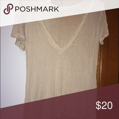 Soft tee Super soft and thin 😍 not brandy !!love this shirt but I never wore it. Just sits in my closet and I would love for someone to enjoy it. Not sure what size would fit and small or medium. Super cute with a bralette! Brandy Melville Tops Tees - Short Sleeve