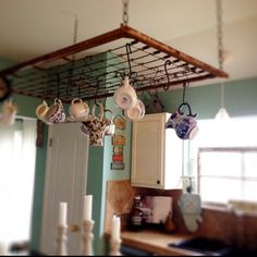 In my kitchen, I'm using an old baby bed spring, as a tea cup and pot holder. A little Alice in Wonderland whimsy :)