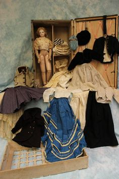 18 Circa 1875 French Jumeau Wood Body fashion doll in trunk with clothes. Marked on the back of her head low down is an incised 4, the size of the