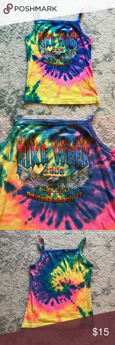 Tie-dye Daytona Beach, FL Bike Week tank top Very bright and colorful (yellow, pink, green, blue, orange, and purple) tie-dye tank top from Daytona Beach, FL (Florida) motorcycle Bike Week in 2006. Still in excellent condition! The tank top is made of 100% cotton. The front of the shirt has Bike Week written in flames with a bald eagle and Daytona Beach, FL 2006. Perfect for any Harley Davidson biker or any lady who likes to ride! 🏍 Tops Tank Tops