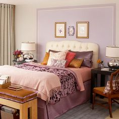 For a clever color boost, paint a section of the wall framing your bed. Here, a white headboard pops against the soft lavender paint, while pretty wall art fills the open space. The main bedding pieces are swathed in purple to match the block of color on the wall. Unexpected amber brown and shades of pink provide visual breaks in the sea of purple.