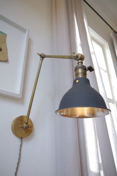 Industrial Articulating Brass Wall Lamp with Dark Gray Spun Metal Shade by LongMadeCo on Etsy https://www.etsy.com/listing/120979600/industrial-articulating-brass-wall-lamp