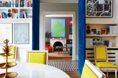 Living rooms with perfect pops of color: The bright and cheerful living and dining spaces in the Notting Hill terrace of Sisley cosmetics vice president, Christine d'Ornano.