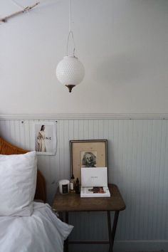 By the bed use a small space side table as an alternative to a nightstand