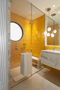 marble vanity with Provencal yellow tiles, a modern update of a landmark hotel, the Monte Carlo Beach Hotel, interior design by India Mahdavi, ©️️ Jean Jacques the heir salle de bain des boys au SS Beautiful Bathrooms, Bathroom Design, Yellow Bathrooms, Yellow Bathroom Tiles, Modern Bathroom, Small Bathroom, Interior, Yellow Tile, Trendy Bathroom