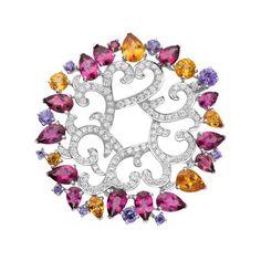 Les jardins Van Cleef & Arpels Haute joaillerie, Clip, grenats mandarins, rubellites, saphirs mauves et diamants. Collection Les Jardins.