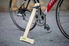 Tired of leaning your fancy bike on your fancy car, or against the wall in your garage? This is your solution.  Made of imported baltic birch 12mm plywood, clear coated, CNC machined, wood bike stand, with Wood decal. Works with most clips pedals (doesnt work with most platform type pedals), works on any adult sized bike. Works especially well with Crank Brother, Shimano, Exustar, iSSi, Look, MSW, Ritchey, Time, VP, and Xpedo clipless pedals.  Requires a pedal shaft size of 3/4 maximum…