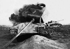 A internal explosion has doomed this Panther V Ausf D-2 turret #322 while another sits abandoned on the battlefield in the distance.