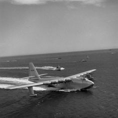 """Howard Hughes' H-4 Hercules troop transport plane, the """"Spruce Goose,"""" on inaugural (and only) flight, Long Beach Harbor, Calif., November 2, 1947."""