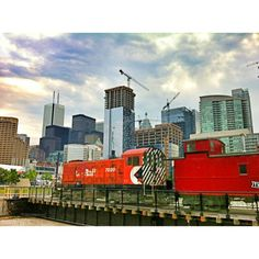 The Roundhouse, near the HarbourFront district of Toronto.  Very cool stuff for any fan of trains.  I took this pic because I loved the contrast of the old rusty trains on the roundhouse, and all the gleaming new buildings being built in the background.  Photo by karinainto