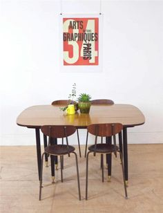Stylish Mid Century 50's Extending Dining Table with Black Legs by G Plan