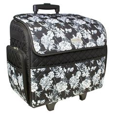 Purchase the Everything Mary™ Rolling Sewing Machine Tote at Michaels.com.  Carry your