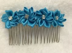 4 turquoise flowers on metal hair comb