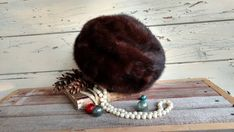 Check out this item in my Etsy shop https://www.etsy.com/listing/489078793/vintage-brown-fur-pillbox-hat-from
