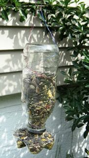 Bird feeder made from a Snapple bottle and the bottom of a 2-liter soda bottle