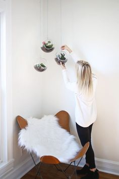 Hanging plant pots add a little Scandi style to any room and are great for displaying plants indoors | The best interior DIY projects | Go to http://www.redonline.co.uk for more decorating ideas like this