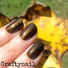 Here's a beautiful brown indie nail polish called Sink in the Silence.