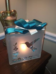 Hummingbird glass block light.....but with disney characters instead