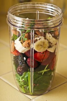 Spinach, Strawberries, Blackberries, Banana, Parsley, Almonds, Flaxseeds, Add coconut water/milk & Blend.