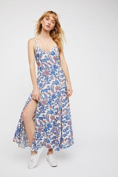 Etienne Strappy Dress | Flowy printed maxi dress featuring multiple slits at the hem with a V-neckline and a slight crochet trim.   * Adjustable straps   * Hidden side zipper closure