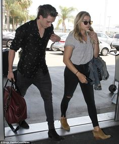 Jet-set lovers: Brooklyn Beckham, 17, and Chloe Grace Moretz, 19, prepared to leave LAX to fly to a secret location on Monday after reuniting last weekend after weeks apart