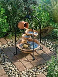 Monroe Cascade Solar on Demand Fountain Terracotta | eBay Great idea for under bird feeding station....put posts and poles in pebble area; no sprouting seeds from feeders. Easy clean up.