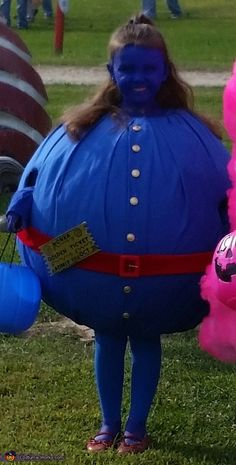 Violet from Willy Wonka - Halloween Costume Contest at Costume- Kimberly: My daughter is a fan of the movie and wanted to be Violet. We used paper mache for the ball then covered it with batting then covered it with blue.