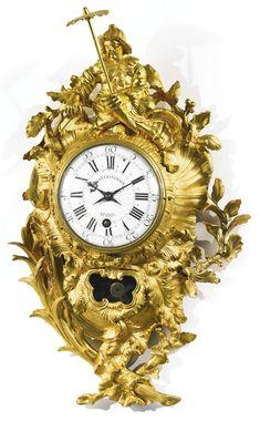 A Louis XV ormolu cartel clock circa 1750, the dial signed Charles Voisin a Paris, movement signed Charles Voisin Paris