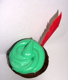 Peter pan cupcake idea. Green frosting & make red candy feather to garnish. Easy peasy!
