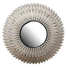 Wall mirror in antiqued silver-gold with a layered startburst silhouette.     Product: Mirror      Construction Material:...