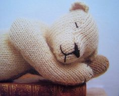 Awww, cute sleeping teddy (and knitted too - bonus)!