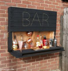How to make an illuminated drop-down outdoor bar from palletsYou can find Pallet bar and more on our website.How to make an illuminated drop-down outdoor bar from pallets Palet Bar, Wooden Pallet Bar, Outdoor Pallet Bar, Diy Pallet Bar, Outdoor Bars, Pallet Patio, Rustic Outdoor Bar, Bar Shelves, Pallet Shelves