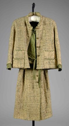 """House of Chanel (French, founded 1913) Designer: Gabrielle """"Coco"""" Chanel (French, Saumur 1883–1971 Paris) Date: ca. 1965 Culture: French Medium: Wool, silk, metal Credit Line: Brooklyn Museum Costume Collection at The Metropolitan Museum of Art, Gift of the Brooklyn Museum, 2009; Gift of Jane Holzer, 1986 Accession Number: 2009.300.8238a–d"""