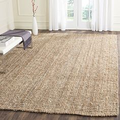 Safavieh Natural Fiber Collection NF447A Hand Woven Natural Jute Area Rug, 8 feet by 10 feet (8' x 10') Safavieh http://www.amazon.com/dp/B002XWFR4M/ref=cm_sw_r_pi_dp_SZE7wb1Q5KMZY