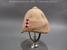 Excellent and rare Boar war period white helmet with super puggaree which has the origianl khaki cover with Scots Guard side flash to both sides. The helmet is solid no soft area's with origianl leather sweat band and silk liner, the size label details 6 British Soldier, British Army, Pith Helmet, British Uniforms, British Colonial, Picts, Military History, Victorian, Soldiers
