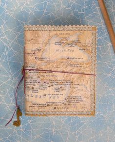 Old Map used as a travel journal. Hand stitching on side to bind pages.. love the triangle tips