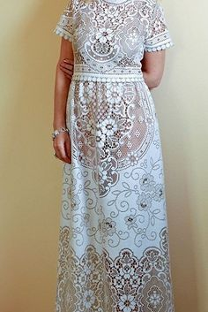This gorgeous embroidered lace design. | 36 Of The Most Effortlessly Beautiful Boho Wedding Dresses Ever